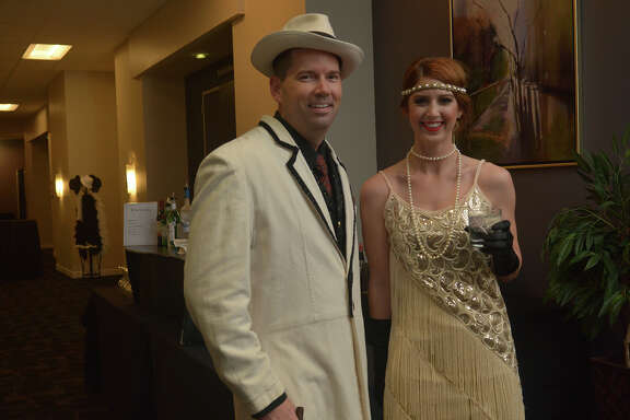 "Jason Culpepper, left, and Sara Theut show off their '20s flare during the Cy-Fair Houston Chamber of Commerce ""A Night of Celebration"" gala at the Norris Conference Center in Houston on Feb. 17, 2017. (Photo by Jerry Baker/Freelance)"