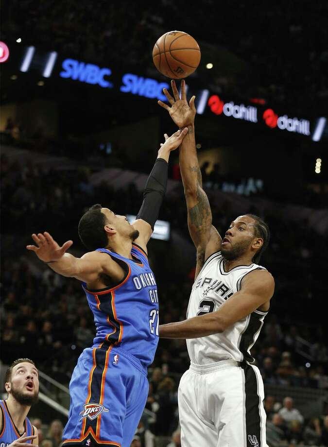 Spurs' Kawhi Leonard (02) shoots over Oklahoma City Thunders' Andre Roberson (21) during their game at the AT&T Center on Tuesday, Jan. 31, 2017. (Kin Man Hui/San Antonio Express-News) Photo: Kin Man Hui, Staff / San Antonio Express-News / ©2017 San Antonio Express-News