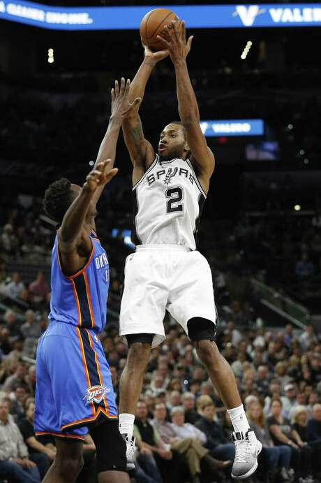 Spurs' Kawhi Leonard (02) shoots over Oklahoma City Thunders' Jerami Grant (09) during their game at the AT&T Center on Tuesday, Jan. 31, 2017. Spurs defeated the Thunder, 108-94. (Kin Man Hui/San Antonio Express-News) Photo: Kin Man Hui, Staff / San Antonio Express-News / ©2017 San Antonio Express-News