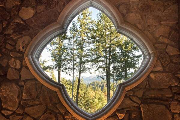 Lokoya�s residential-style tasting room is on the top floor of a remodeled stone castle hand-built in the 1970s on Napa�s Spring Mountain.�A quatrefoil window at Lokoya�s new stand-alone tasting room in St. Helena overlooks forested Spring Mountain.