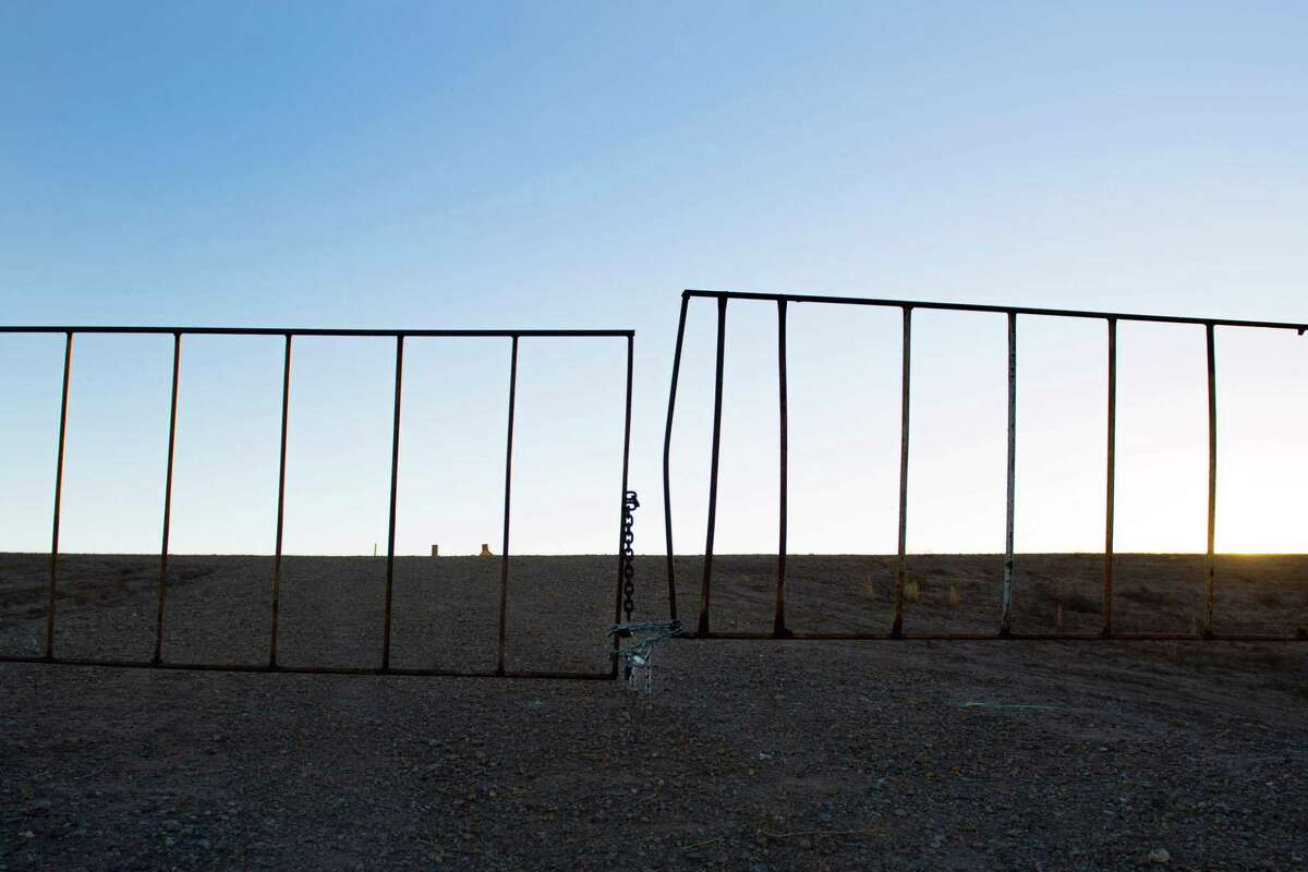 TOPSHOT - A worn gate marks the boundary near the US/Mexico border in Presidio, Texas, on February 20, 2017. ATTENTION EDITORS: This image is part of an ongoing AFP photo project documenting the life on the two sides of the US/Mexico border simultaneously by two photographers traveling for ten days from California to Texas on the US side and from Baja California to Tamaulipas on the Mexican side between February 13 and 22, 2017. You can find all the images with the keyword : BORDERPROJECT2017 on our wire and on www.afpforum.com / AFP PHOTO / JIM WATSONJIM WATSON/AFP/Getty Images
