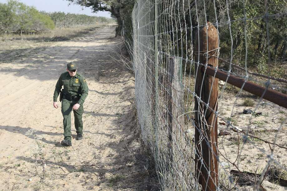 U.S. Border Patrol Agent Nicholas Ovington checks for tracks along a fence line at a ranch just south of Falfurrias, Texas, Wednesday, December 19, 2012. Immigrant apprehensions for the Rio Grande Sector, which includes Falfurrias, have surged by more than 40 percent for comparable 10-month periods in 2011 and 2012. Photo: Jerry Lara, Staff / San Antonio Express-News / © 2012 San Antonio Express-News