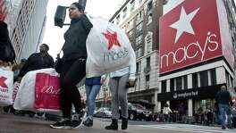 Macy's, the nation's largest department store chain, says its earnings for the quarter that includes the holiday period dropped nearly 13 percent to $475 million, Although profit beat Wall Street expectations, Macy's said it would post another year of sales declines for a key revenue measure.