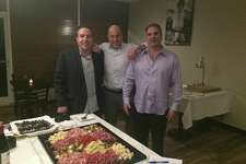 Paul Ganassini, the general manager far left along with owners Dino Tetu and Vincent Noce at Monday's grand opening of Lulu Pazzo on Ansonia's Main Street.
