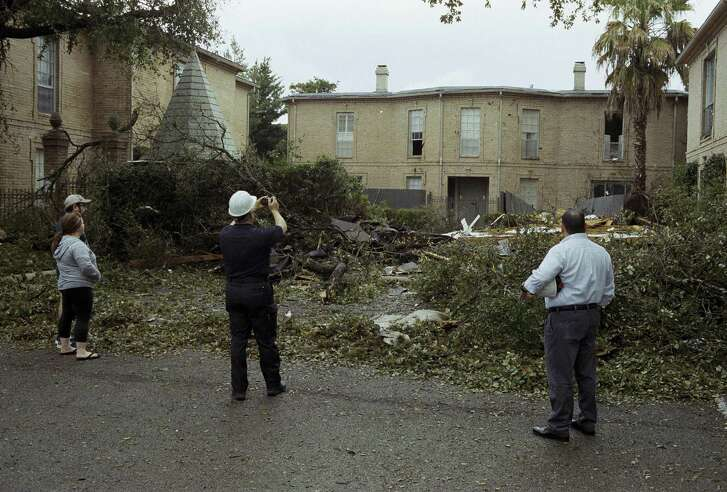 Residents and city inspectors survey storm damage, Monday, Feb. 20, 2017, at Chateau Dijon condominiums in Alamo Heights. (Darren Abate/For the San Antonio Express-News)