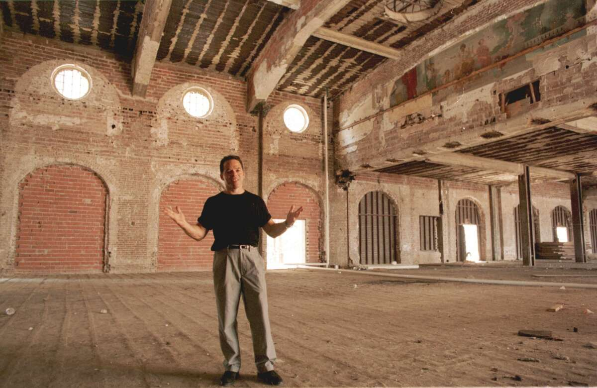 SHOT 08/22/1997 BY E. JOSEPH DEERING. Developer Randall Davis, shown amid the renovation, is using tax benefits and hard work to turn the Rice Hotel into lofts that should be ready by mid-spring.