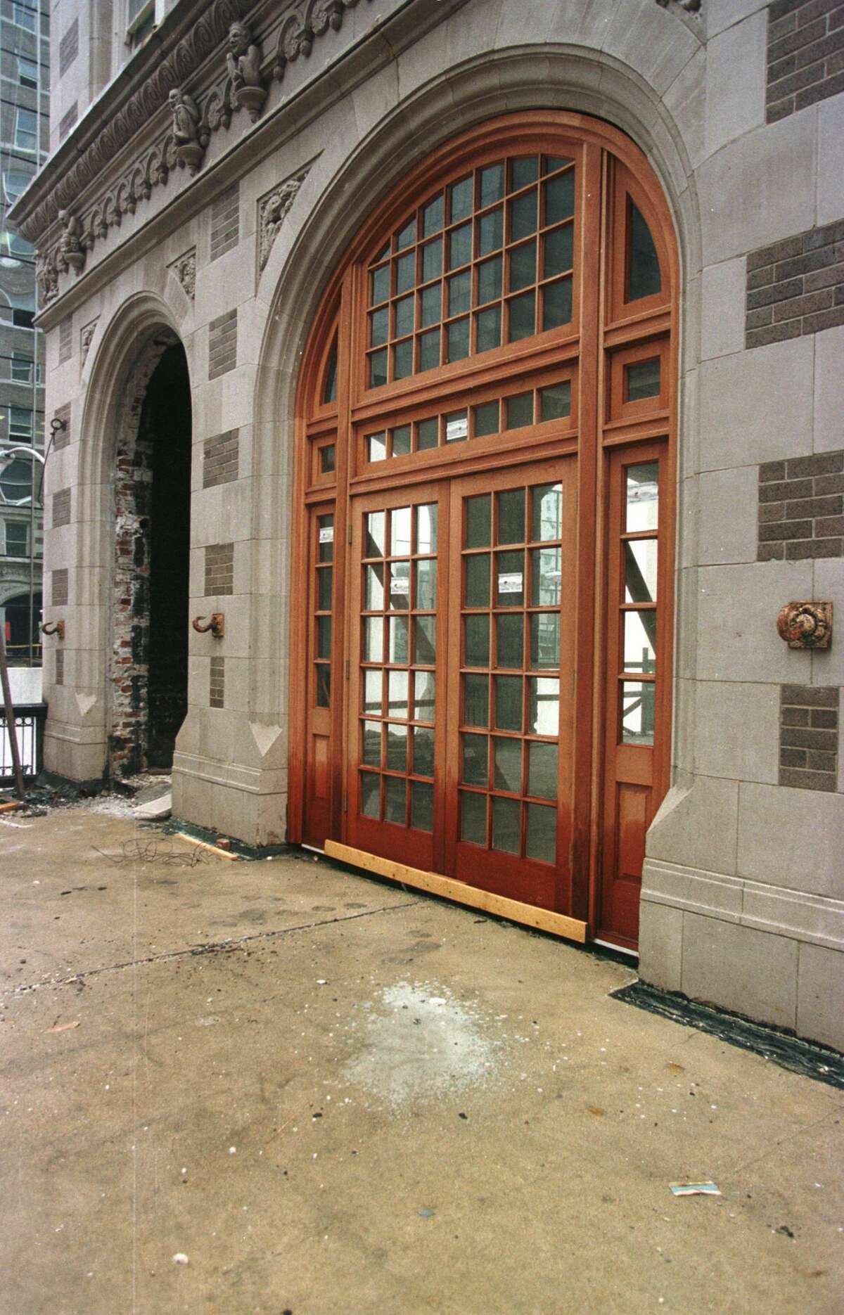 With its graceful french doors now replaced, this archway leads from a second-floor bar to a balcony at the Rice Hotel. At street level the balcony forms a promenade to shelter pedestrians from summer sun.
