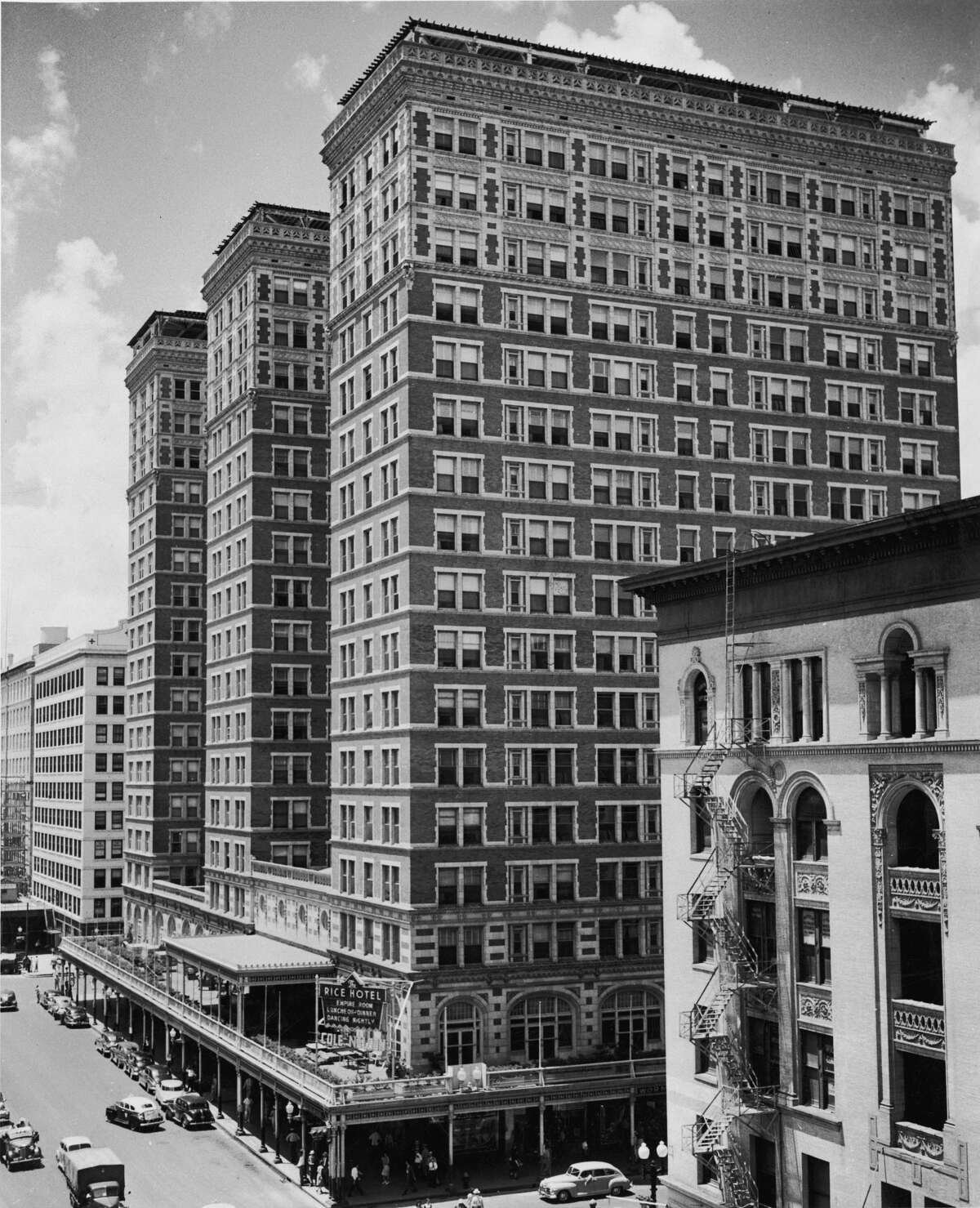 When the 17-story Rice Hotel opened in 1913, it was the tallest building in Houston. This photo, taken decades later, shows the third tower (background) added in 1926.