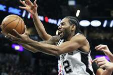 Kawhi Leoanrd  stretches the ball into the lane as the Spurs host the Sixers at the AT&T Center on February 2, 2017.