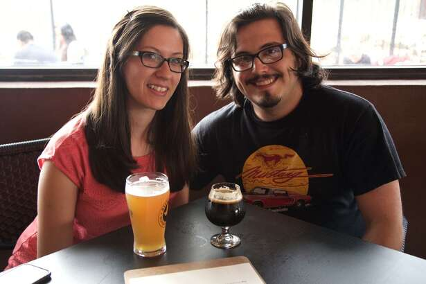 Phoebe Boyle and Jake Castellano enjoy their beer where it's made at Weathered Souls Brewing Co.