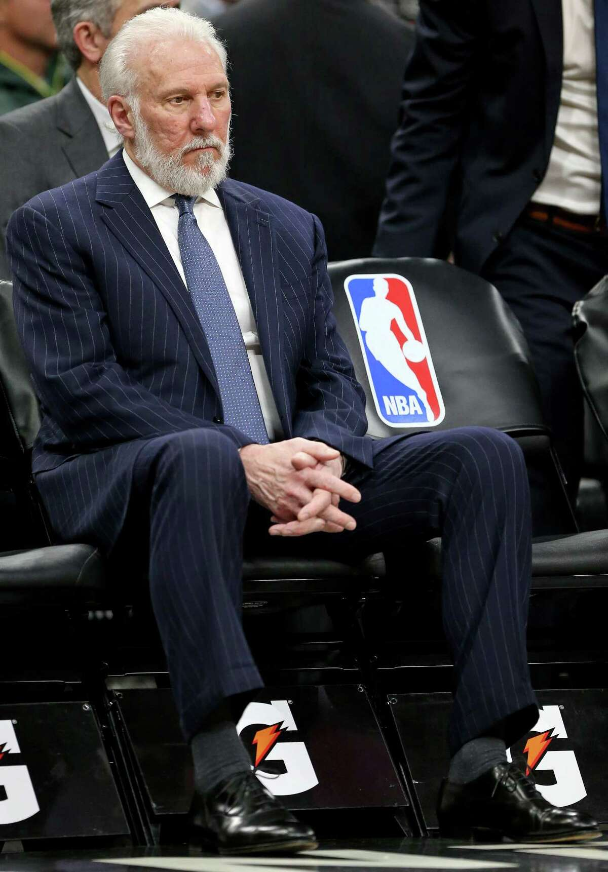 San Antonio Spurs head coach Gregg Popovich sits on the bench during a second half timeout against the Denver Nuggets Saturday Feb. 4, 2017 at the AT&T Center. The Spurs won 121-97.
