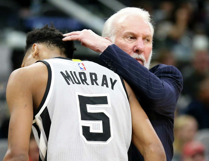San Antonio Spurs head coach Gregg Popovich greets  Dejounte Murray as he heads to the bench during second half action against the Denver Nuggets  Saturday Feb. 4, 2017 at the AT&T Center. The Spurs won 121-97.