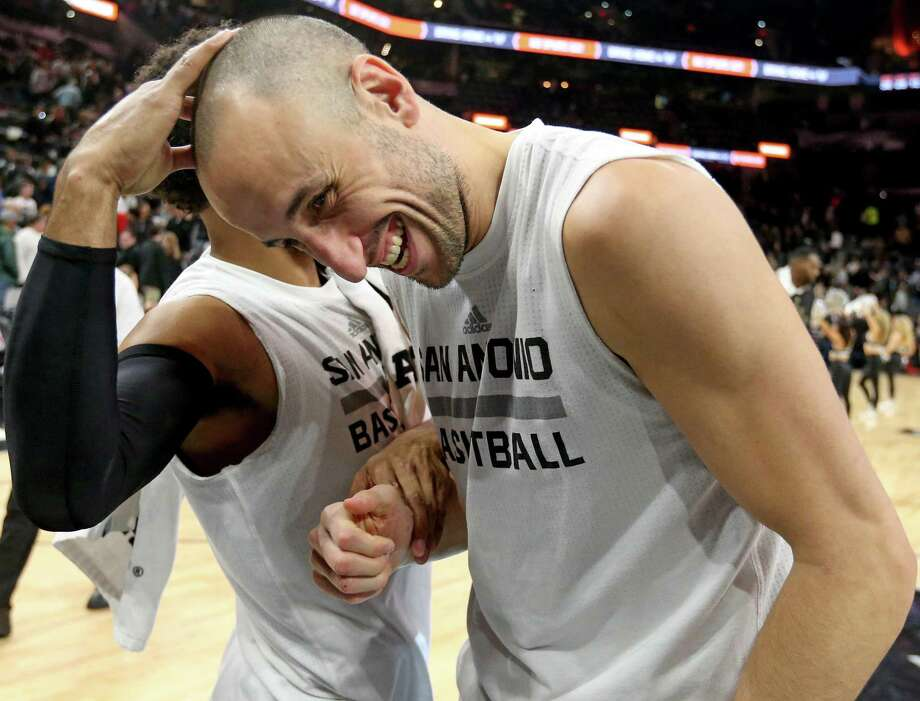 San Antonio Spurs' Patty Mills jokes with Manu Ginobili after the game with the Denver Nuggets Saturday Feb. 4, 2017 at the AT&T Center. Will this be the Argentine's last season with the Silver & Black? His latest comments have left the door wide open for a return. Photo: Edward A. Ornelas, Staff / San Antonio Express-News / © 2017 San Antonio Express-News