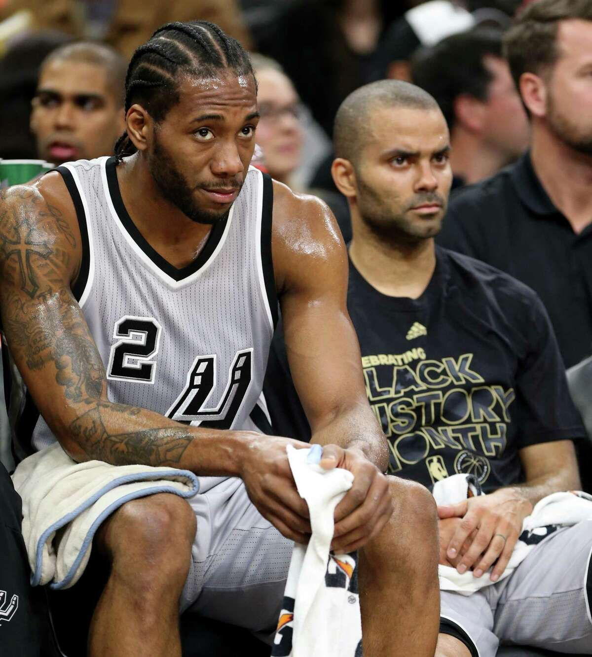 San Antonio Spurs' Kawhi Leonard and Tony Parker watch action against the Denver Nuggets from the bench Saturday Feb. 4, 2017 at the AT&T Center.