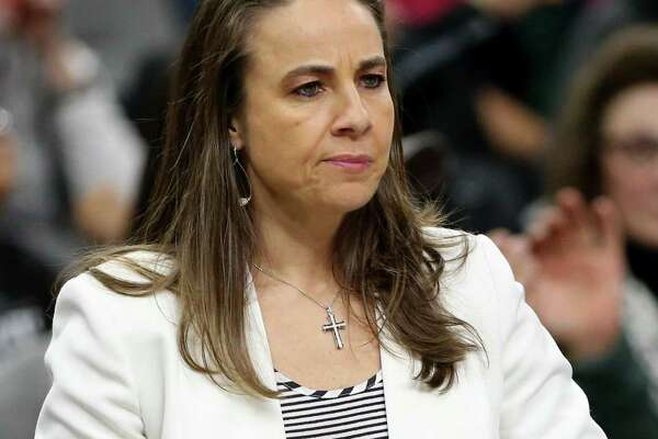 San Antonio Spurs assistant coach Becky Hammon stands during a timeout in first half action against the Denver Nuggets Saturday Feb. 4, 2017 at the AT&T Center.