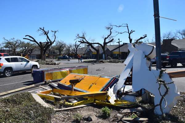 Work crews in locations in and around the Alamo Heights area worked on Tuesday, Feb. 20, 2017, to clean up the mess caused  by a tornado storm two days prior.