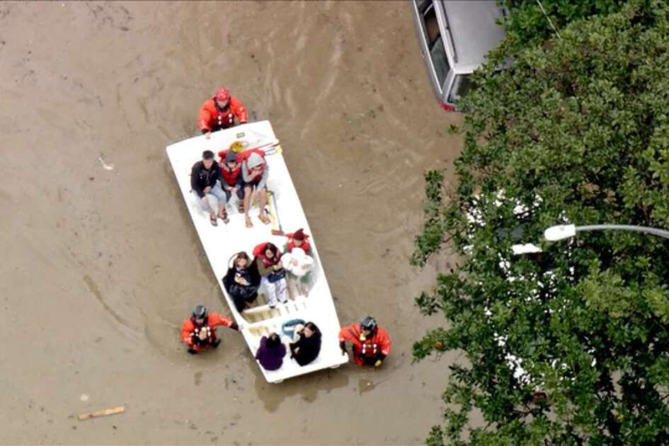 Firefighters are using boats to rescue residents trapped in a flooded neighborhood in San Jose on Tuesday Feb. 21, 2017.