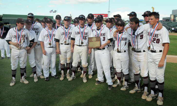 The George Ranch Longhorns hold their consolation trophy after their 4-1 loss to Victoria East in their Class 4A 2014 UIL Baseball State Championships matchup at Dell Diamond in Round Rock on Thursday.