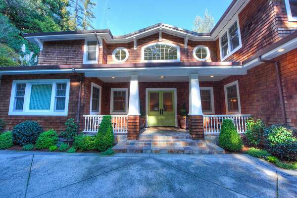 The shingled main home offers six bedrooms and five bathrooms.�