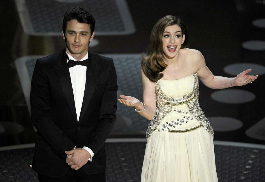 Hosts James Franco, left, and Anne Hathaway onstage during the 83rd Academy Awards on Sunday, Feb. 27, 2011, in Hollywood. Photo: Mark J. Terrill / Associated Press / AP