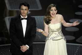 Hosts James Franco, left, and Anne Hathaway onstage during the 83rd Academy Awards on Sunday, Feb. 27, 2011, in Hollywood.