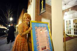 Avon's director of development and marketing Louisa Greene, the event's unofficial MC, poses next to the Bollywood-themed poster last year outside of the Avon Theatre.