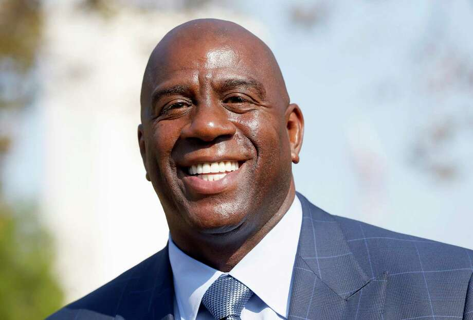 FILE - In a Tuesday, Aug. 23, 2016 file photo, former Los Angeles Lakers star Magic Johnson speaks at a groundbreaking ceremony for a stadium which will be home to the Los Angeles Football Club in Los Angeles. The Los Angeles Lakers fired general manager Mitch Kupchak on Tuesday, Feb. 21, 2017,  and put Magic Johnson in charge of basketball operations in a major shake-up of the struggling franchise's front office.  (AP Photo/Nick Ut, File) Photo: Nick Ut, STF / Copyright 2016 The Associated Press. All rights reserved. This material may not be published, broadcast, rewritten or redistribu