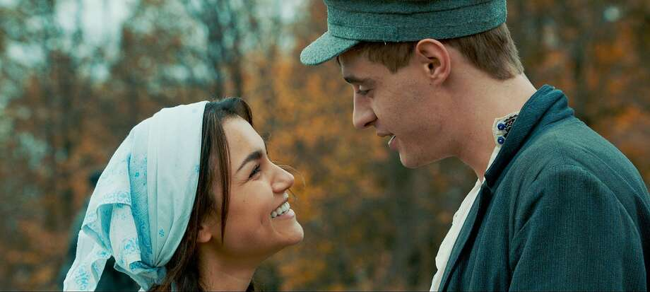 "Samantha Barks and Max Irons play young lovers separated by Stalin's reign of terror in ""Bitter Harvest."" Photo: Associated Press"