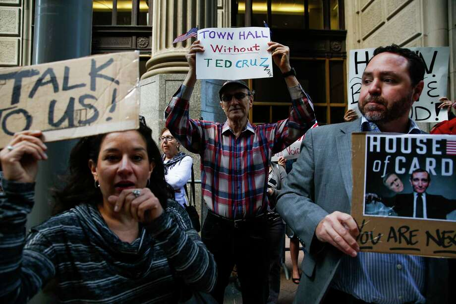 "Eric Eubanks, center, joins with other protestors as they hold a ""Town Hall  Without Ted Cruz"" outside Cruz's office in downtown Houston Tuesday, Feb. 21, 2017. The protest is a response to Cruz's apparent refusal to meet with constituents or hold a Town Hall during the February recess. A small group of protestors were allowed up to speak with senior members of Cruz's staff. Photo: Michael Ciaglo, Houston Chronicle / Michael Ciaglo"