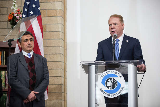 Hisham Farajallah, spokesman for Idris Mosque, stands with Mayor Ed Murray during the State of the City address on Tuesday, Feb. 21, 2017.