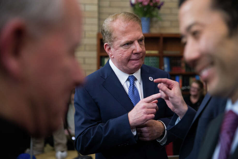 Seattle Mayor Ed Murray and his husband Michael Shiosaki greet attendees following the State of the City address at Idris Mosque. A product of the Kennedy era in American politics, the mayor is an advocate of activist, problem-solving government.  Photo: GRANT HINDSLEY, SEATTLEPI.COM / SEATTLEPI.COM