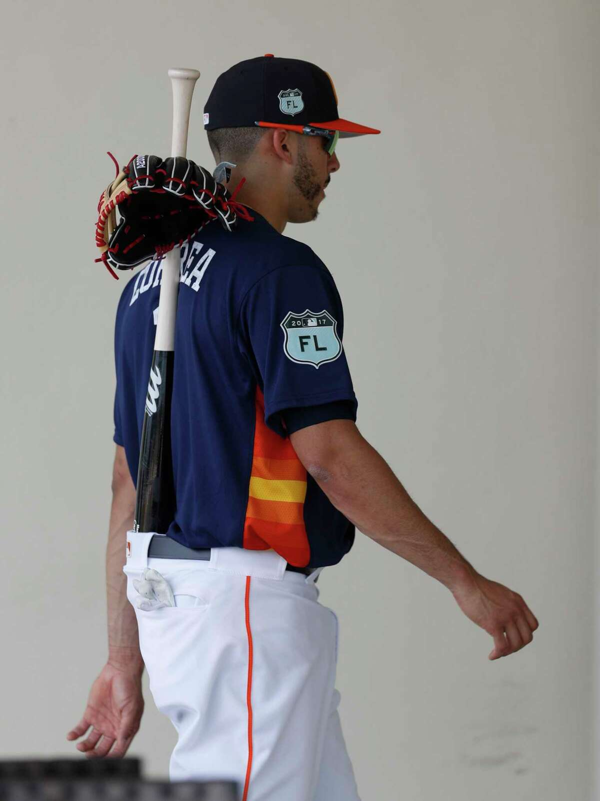 Houston Astros shortstop Carlos Correa (1) walks back to the clubhouse with his bat and glove in his back pocket during spring training at The Ballpark of the Palm Beaches, in West Palm Beach, Florida, Tuesday, February 21, 2017.