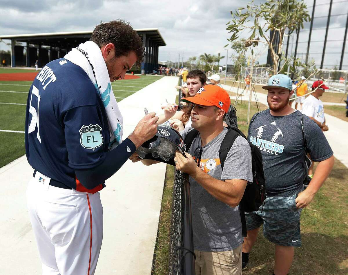 Houston Astros pitcher James Hoyt (51) signs autographs during spring training at The Ballpark of the Palm Beaches, in West Palm Beach, Florida, Tuesday, February 21, 2017.