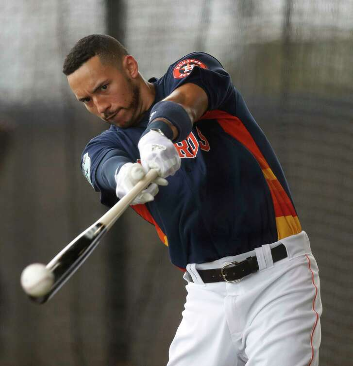 Houston Astros shortstop Carlos Correa (1) takes batting practice in the batting cages during spring training at The Ballpark of the Palm Beaches, in West Palm Beach, Florida, Tuesday, February 21, 2017.