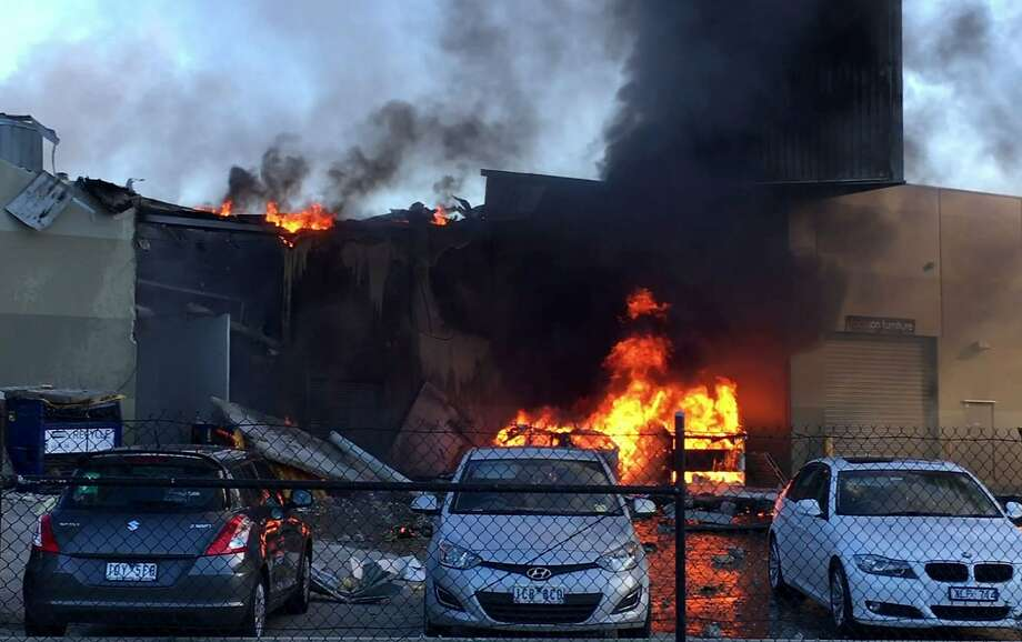 Fire and smoke rise in the aftermath of the crash of a small plane into a shopping center in Melbourne, Australia, as seen in a TV video frame grab. Photo: JORDAN FOURACRE, AFP/Getty Images