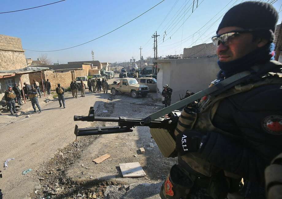 Iraqi security forces gather in a village south of Mosul as they prepare for an assault on the city. Photo: AHMAD AL-RUBAYE, AFP/Getty Images