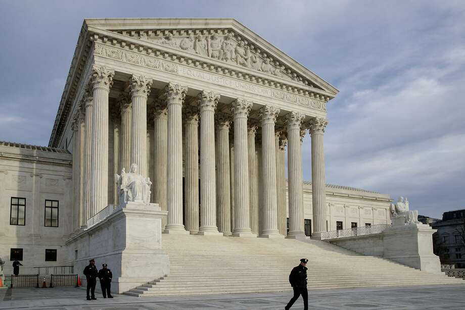 In this Feb. 14, 2017 photo, The Supreme Court is seen at day's end in Washington.  The Supreme Court on Tuesday is hearing an appeal to a case involving a 2010 shooting of a Mexican boy by a U.S. Border Patrol Agent.  (AP Photo/J. Scott Applewhite) Photo: J. Scott Applewhite, Associated Press