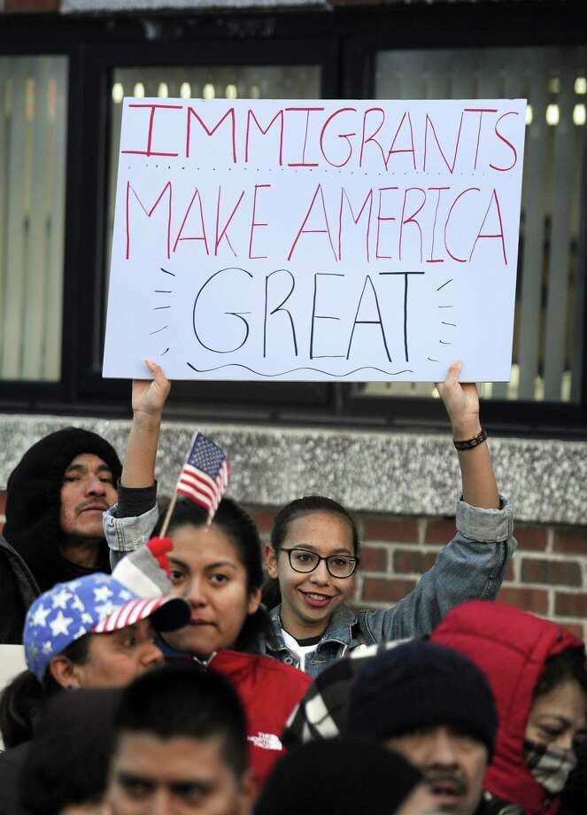 "Gabby Perez, 17, of Danbury, holds a ""Immigrants make America great"" sign at a ""Day without immigrants"" rally at the Danbury City Hall Thursday, February 16, 2017. Photo: Carol Kaliff / Hearst Connecticut Media / The News-Times"