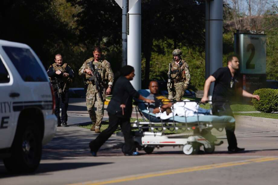 """SWAT officersswarm the area around Ben Taub Hospital after hearing reports of an active shooter on the campus in February2017. An editorial in the New England Journal of Medicine calls for a different strategy in such health-care settings than the traditional """"run, hide, fight."""" Photo: Michael Ciaglo / Houston Chronicle"""