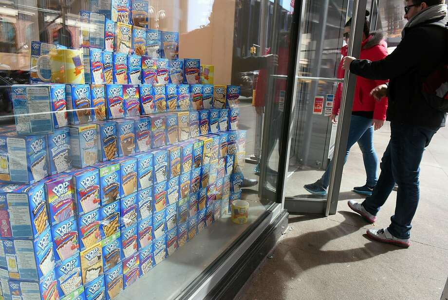 Customers check out the Pop-Tarts Cafe in Times Squar in New York. Photo: Diane Bondareff, Associated Press