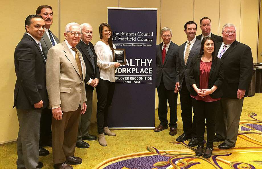 Grade A Markets team members John Kapoor, Jack SantaMaria, Sam Cingari, Rocky Cingari, Cora Ragaini, Chip Cingari, Dominick Cingari, Jenna Hourani, Darren Powers and Dave Roche celebrate receiving a Innovation Award at the Business Council of Fairfield County's Workplace Wellness Program ceremony in Stamford on Feb. 14. Photo: Contributed Photo / The News-Times Contributed