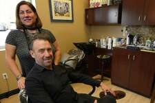 Wayne and Lisa  DeVingo pose in Wayne Salon in Stamford, Conn. on Feb. 18, 2017. The salon recently relocated to a space in the My Salon Suite complex on High Ridge Road.
