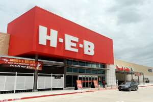 A car passes by the new H-E-B on Tuesday. The new H-E-B location on College Street held a preview of their new store for the media and VIPs on Tuesday. The 56,000 square foot store will open to the public at 6 a.m. Wednesday. Photo taken Tuesday 5/26/15 Jake Daniels/The Enterprise