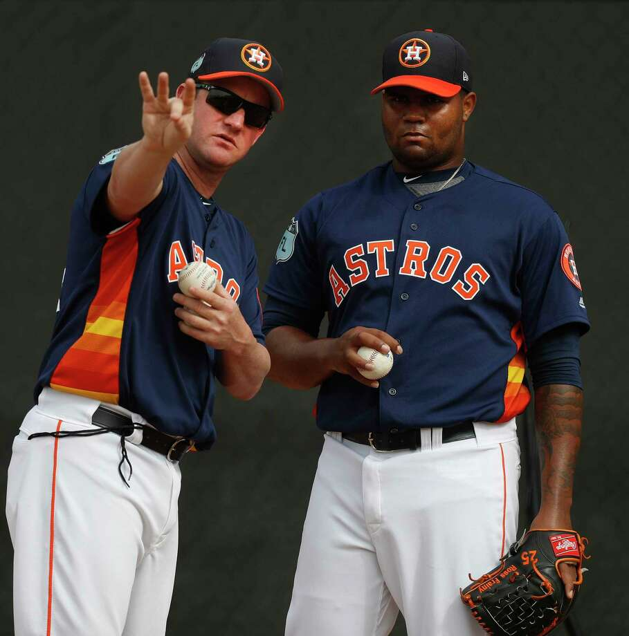 Roy Oswalt, left, and top prospect Francis Martes discussed such things as how to grip a changeup. Photo: Karen Warren, Staff Photographer / 2017 Houston Chronicle