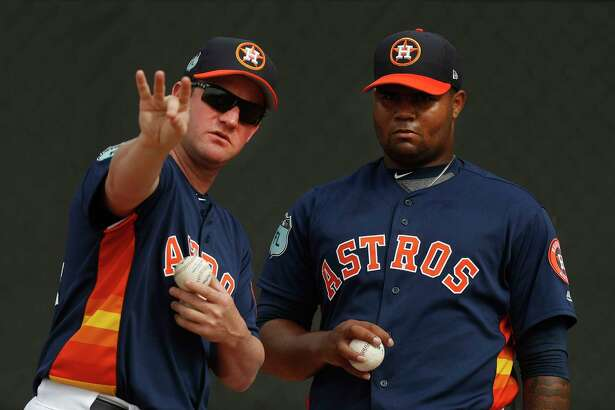 Former Houston Astros pitcher Roy Oswalt talks with pitcher Francis Martes (79) as he pitched during spring training at The Ballpark of the Palm Beaches, in West Palm Beach, Florida, Tuesday, February 21, 2017. ( Karen Warren / Houston Chronicle )