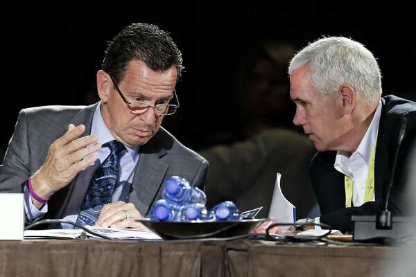 Connecticut Gov. Dan Malloy, left, talks with Indiana Gov. Mike Pence, right, at the National Governors Association convention in Nashville, Tenn. in 2014.