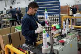 A worker at a SodaStream factory in Israel, with the company producing devices to make carbonated drinks at home. AFP PHOTO/MENAHEM KAHANAMENAHEM KAHANA/AFP/Getty Images