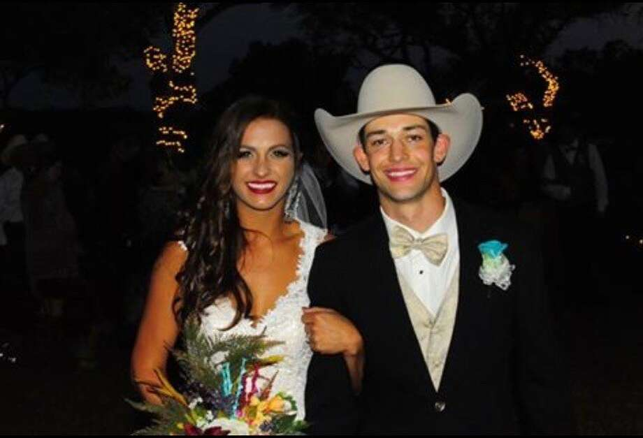 "Ty Pozzobon and his wife, Jayd on their wedding day October 11, 2015 in Yoakum, Texas. Jayd says she doesn't want to kill the sport of bull riding after her husband's death, but does want to help ""raise the awareness of the corroding and crippling side effects of concussions in hopes of bettering the sport of bull riding."" Photo: Courtesy Of Jayd Pozzobon"