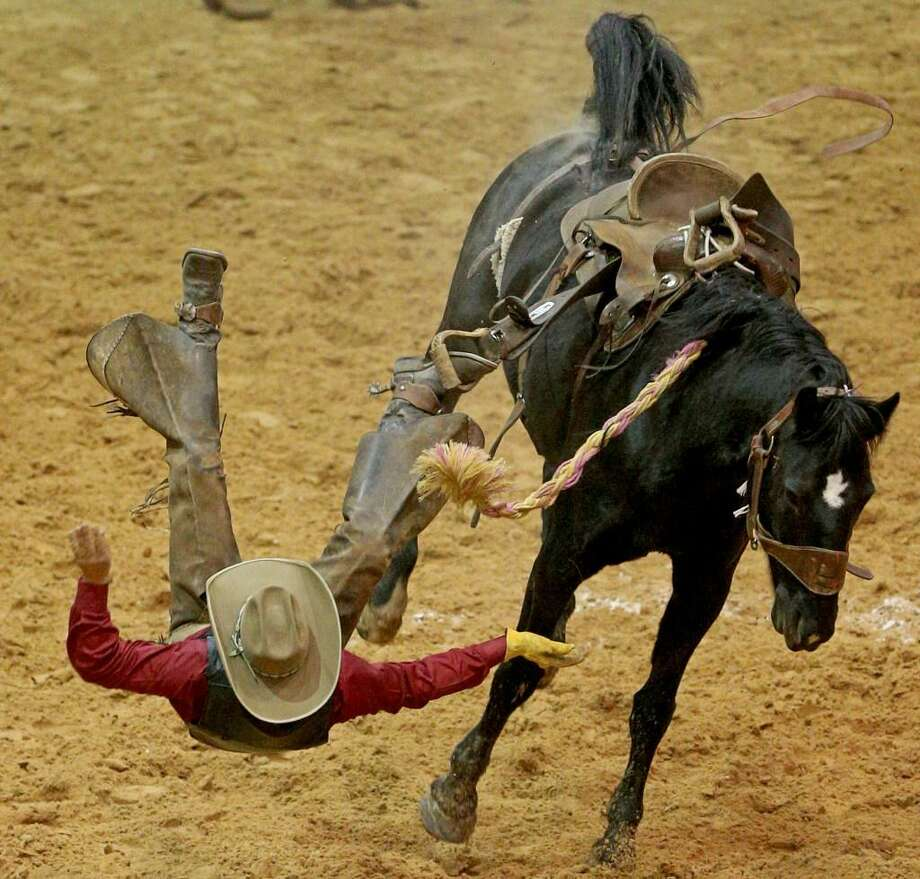 A cowboy is bucked off his horse in the Ranch Bronc Riding event during the 21st World Championship Ranch Rodeo held Friday Nov. 11, 2016 at the Amarillo Civic Center in Amarillo, Tx. Photo: Edward Ornelas /San Antonio Express-News