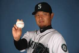 PEORIA, AZ - FEBRUARY 20:  Pitcher Hisashi Iwakuma #18 of the Seattle Mariners poses for a portrait during photo day at Peoria Stadium on February 20, 2017 in Peoria, Arizona.  (Photo by Christian Petersen/Getty Images)